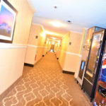 hotel hallway with vending machines and ice dispenser
